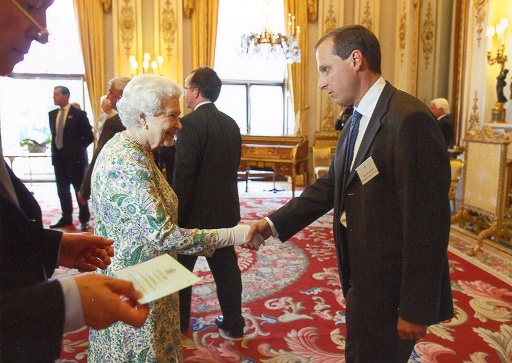 John Donner, Sugdens Director meets the Queen